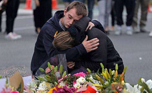 מתאבלים על הרצח בניו זילנד (צילום: AP, חדשות)