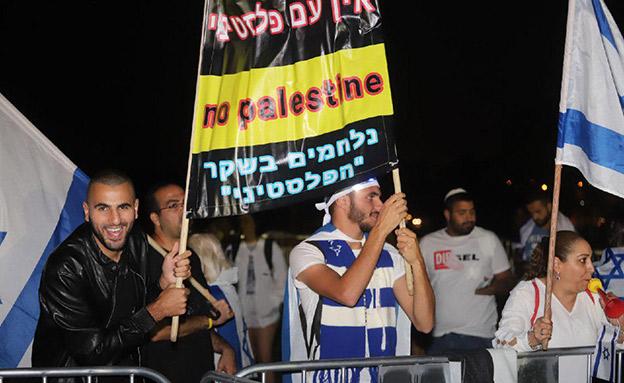 מפגינים בטקס בשנה שעברה (צילום: איתן אלחדז/TPS, חדשות)