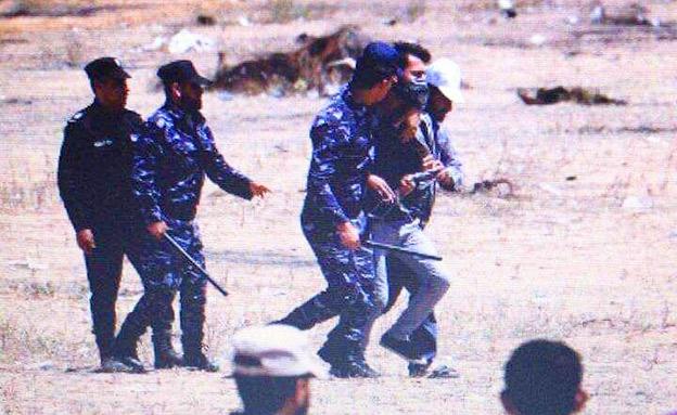 חמאס מונע ממפגינים להתקרב לגדר (צילום: חדשות)