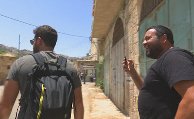 עופר אוחנה מתעמת עם דין יששכרוף (צילום: החדשות)