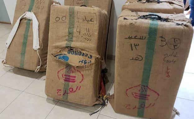 15 שקי הסמים שנתפסו (צילום: דוברות המשטרה, חדשות)