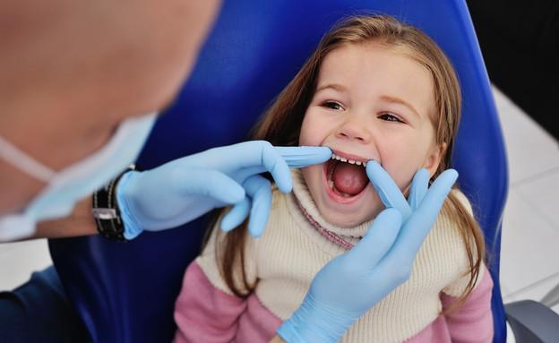ילדה אצל רופא שיניים (אילוסטרציה: kateafter | Shutterstock.com )