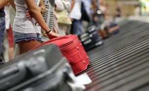 מסוע מזוודות (צילום:  Brian A Jackson, shutterstock)