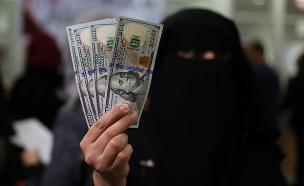 """""""רוצים את הכסף לעניים"""" (צילום: רויטרס, חדשות)"""