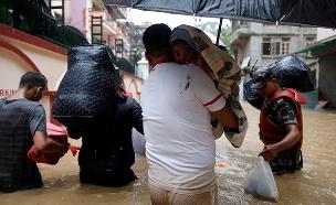30 הרוגים בשטפונות, 18 מוגדרים נעדרים (צילום: רויטרס, חדשות)