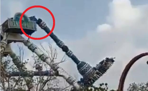 מתקן התפרק באוויר בפארק שעשועים (צילום: טוויטר\@HitenPithadiya)