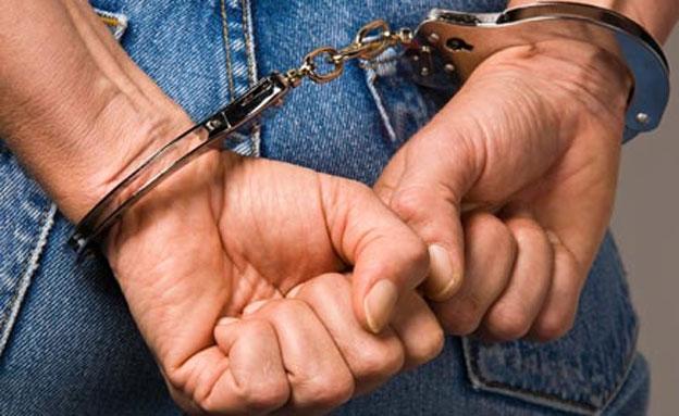 אזיקים, אסיר, כלא (צילום: Lisa S., Shutterstock)