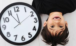 ילד עם שעון (צילום: By ZouZou, shutterstock)