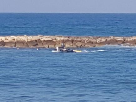 חיפושים בתל אביב אחר צעיר שנעדר בים (צילום: דוברות המשטרה)