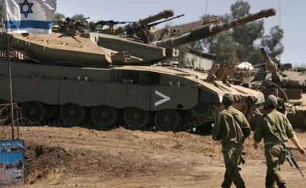 """חיילי צה""""ל בכוננות בגבול הצפון (צילום: חדשות 12)"""