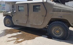 רכב צבאי שהותקף על ידי מטען שהושלך מרחפן (צילום: Christine and Steve Tan, ללא)