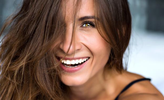 אישה מאושרת (צילום:  Ann Haritonenko, shutterstock)