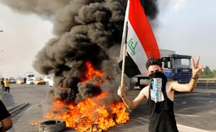 הפגנות המוניות בעירק (צילום: רויטרס)