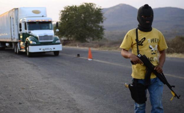 חייל קרטל (צילום: ALFREDO ESTRELLA/AFP/Getty Images)