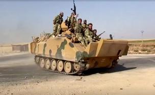 """מורדים סורים בצפון המדינה במבצע """"מעיין השלום"""" (צילום: רויטרס)"""