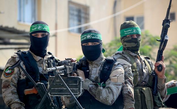 פעילי טרור חמושים מרצועת עזה (צילום: עבד רחים חטיב, פלאש 90)