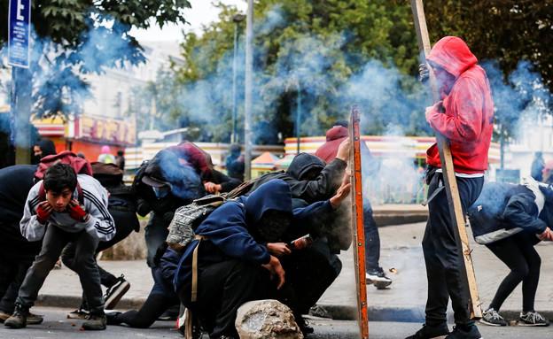 מפגינים בואלפאריסו (צילום: רויטרס, שי פרנקו, רויטרס)