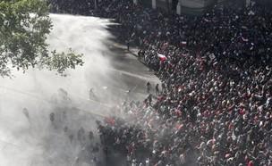 עימותים בין המפגינים לכוחות הביטחון בצ'ילה (צילום: AP)