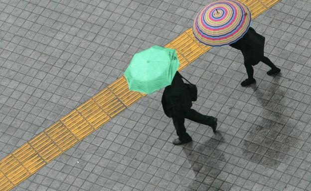 מטריות, גשם, חורף (צילום: רויטרס)