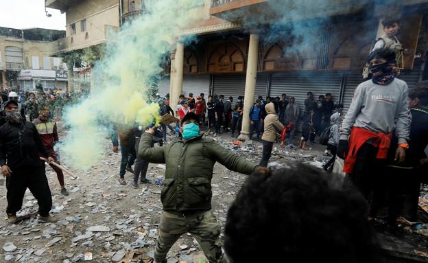 מחאות נגד אירן בעירק (צילום: רויטרס)