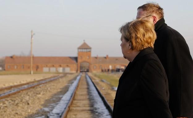 אנגלה מרקל בביקורה באושוויץ (צילום: Sakchai Lalit | AP)