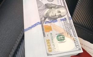 נהג מונית מצא מאות דולרים (צילום: משה ברקת)