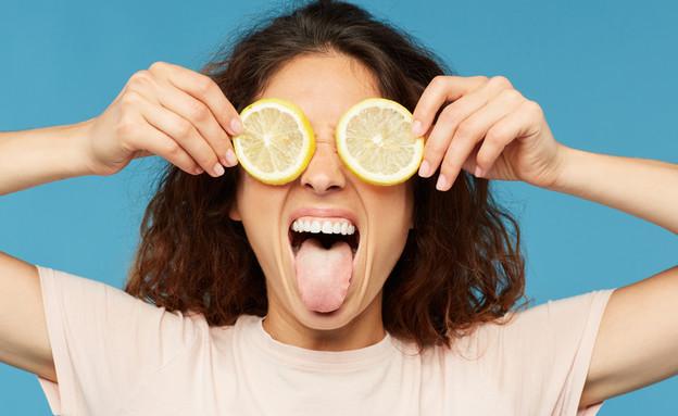 פרצוף חמוץ, לימון (צילום: By SeventyFour, shutterstock)