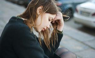 אישה עצובה (צילום:  Concept Photo, shutterstock)