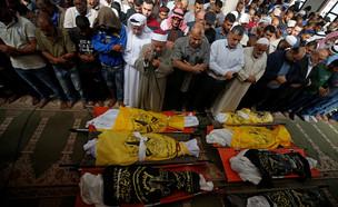 """מות שמונה בני משפחה במבצע """"חגורה שחורה"""" בעזה (צילום: רויטרס)"""