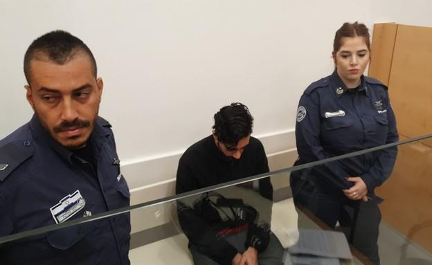 יונתן פדידה בבית המשפט (צילום: החדשות 12)