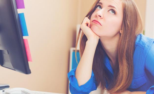 עובדת משועממת (צילום:  TierneyMJ, shutterstock)