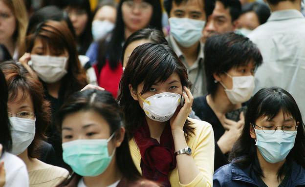 מגפה בסין 1 (צילום: gettyimages: Christian Keenan / Stringer)