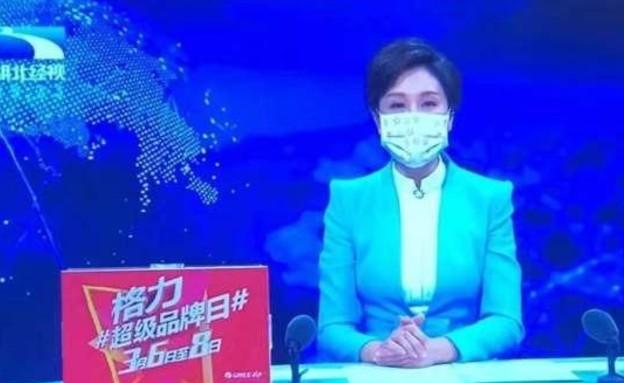קריינית הטלוויזיה של הונאן מדווחת על הנגיף הסיני ה