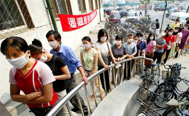 הנגיף בסין (צילום: רויטרס)