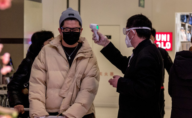 בדיקת חום לנוסעים בסין
