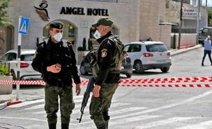 קורונה בבית ג'אלא (עיבוד: MUSA AL SHAER, AFP)