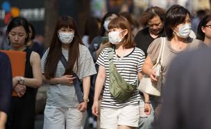 אנשים בדרום קוריאה (צילום: yochika photographer / Shutterstock.com)
