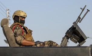 כוח איראני (צילום: HUSSEIN FALEH/AFP via Getty Images)