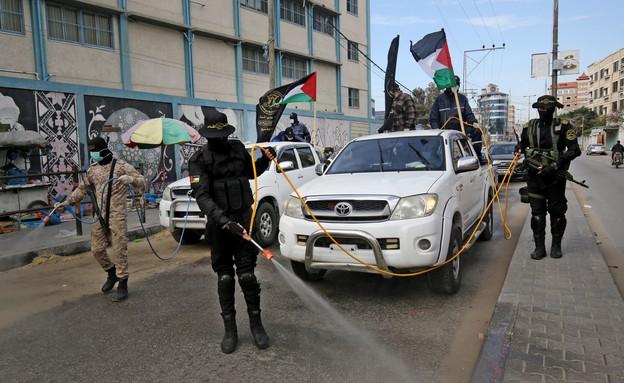 אנשי הג'יהאד האיסלמי מחטאים רחוב ברפי (צילום: SAID KHATIB, getty images)