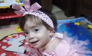 """תינוקת בת תשעה חודשים חלתה בקורונה (צילום: מתוך """"חדשות הבוקר"""" , קשת 12)"""