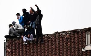 מרד אסירים (צילום:  MIGUEL MEDINA/AFP via Getty Images)