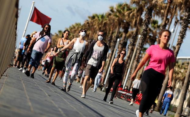 רצים במדריד, ספרד, אחרי ההקלות בהסגר (צילום: reuters)