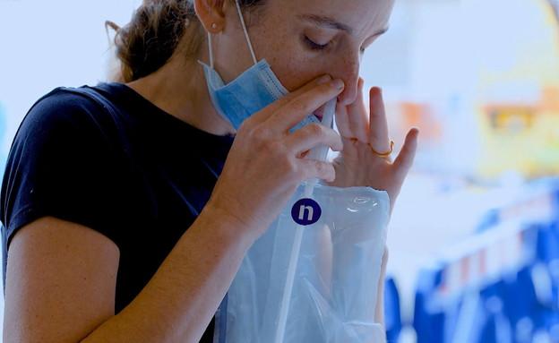 בדיקת קורונה (צילום: החדשות 12)