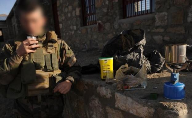חייל, קפה (צילום: MASSOUD HOSSAINI/AFP via Getty Images)