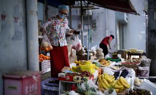 סין מציעה לחוואים לעבור לגדל פירות וירקות - במקום  (צילום: אלי סונג, רויטרס)