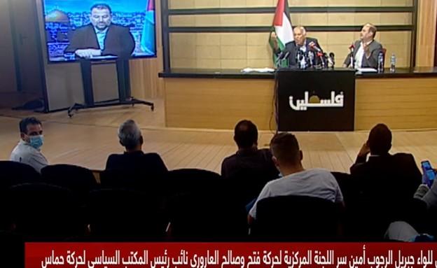 """יו""""ר הרשימה המשותפת איימן עודה במסיבת העיתונאים עם אנשי חמאס ופת""""ח (צילום: הטלוויזיה הפלסטינית)"""
