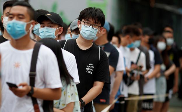 סין קורונה מסכה (צילום: רויטרס)