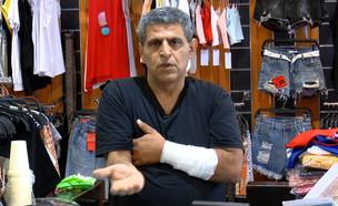 רמי יצחק בעל עסק מחולון שפגע בעצמו (צילום: N12)
