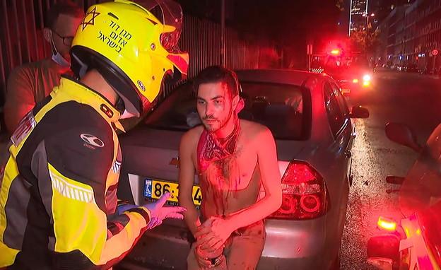 מפגין הותקף בתל אביב (צילום: N12)