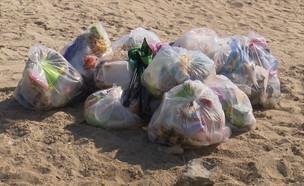 טובעים בזבל  (צילום: החדשות 12, חוסין אל אוברה)